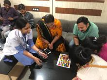 Dietician Navnidhi Vyas playing the game with waiting families of the patient