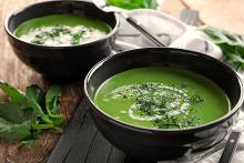 Nutritious and protein rich spinach soup in 2 bowls for oral cancer patients